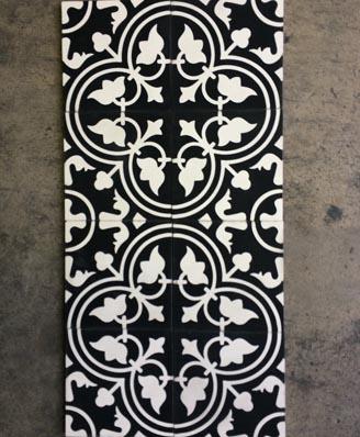 Black and white cement tiles in a hall of London England Cimenterie de la Tour