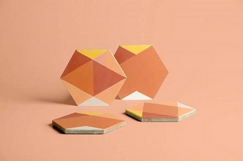 carreaux de ciment orange designés par Eli Gutierrez et fabriqués par Cimenterie de la Tour